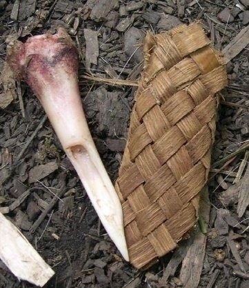 Actual image of another bone knife and it's woven sheath