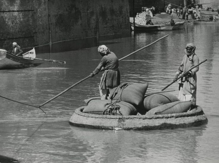 black and white image of a coracle-made of animal skins and covered with bitumen (waterproofing)